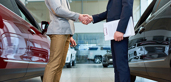 Man buying a new car